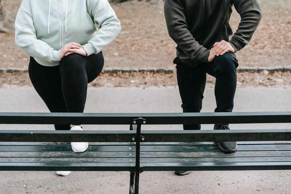 A couple of people that are sitting on a bench